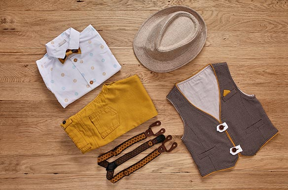 Top view photo of the boy's clothes with accessories