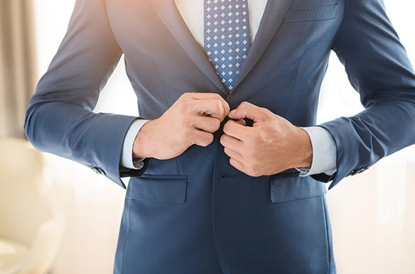 Business man wearing a suit in the right size
